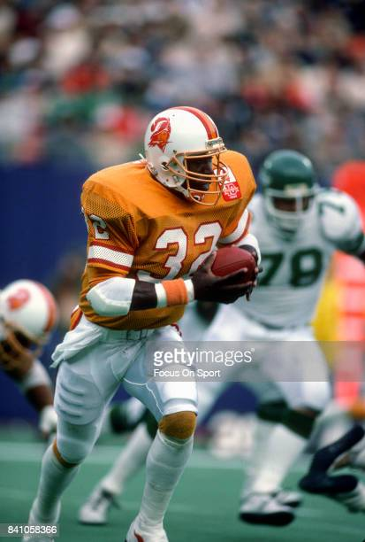 James Wilder of the Tampa Bay Buccaneers carries the ball against the New York Jets during an NFL football game November 17 1985 at The Meadowlands...