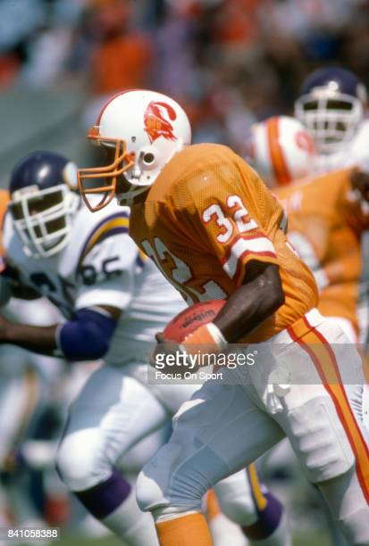 James Wilder of the Tampa Bay Buccaneers carries the ball against the Minnesota Vikings during an NFL football game October 23 1988 at Tampa Stadium...