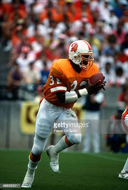 James Wilder of the Tampa Bay Buccaneers carries the ball during an NFL football game circa 1985 at Tampa Stadium in Tampa Bay Florida Wilder played...