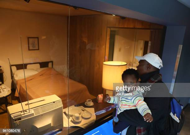 James Williams and his son Conner Williams looks in at room 306 at the Lorraine Motel where Dr Martin Luther King Jr stayed before he was murdered...