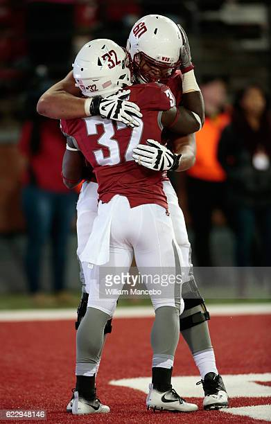James Williams of the Washington State Cougars celebrates his touchdown in the second half against the California Golden Bears with teammate Andre...