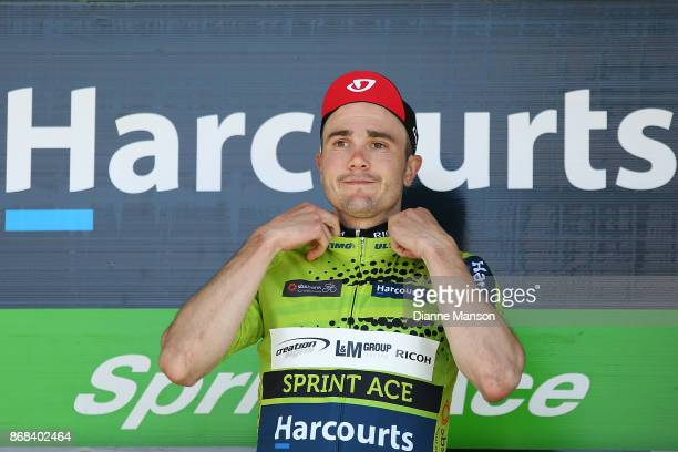 James Williamson of Alexandra Creation Signs L M Group Ricoh receives the sprint ace jersey on stage two day three from Riverton to Te Anau of during...