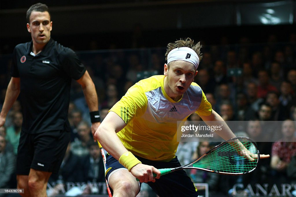 James Willstrop of England (R) in action against Peter Barker of England in the final of the Canary Wharf Squash Classic on March 22, 2013 in London, England.