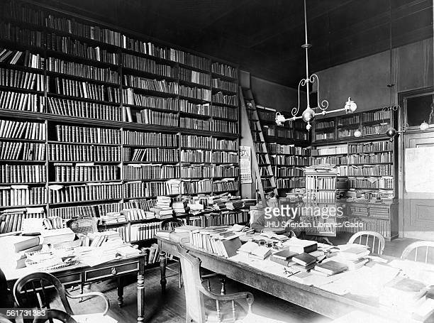 James Wilson Bright Candid photograph in office with his library c50 years of age 1905