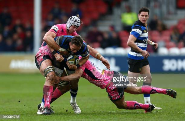 James Wilson of Bath is tackled by Toby Salmon of Exeter Chiefs and Ollie Devoto of Exeter Chiefs during the AngloWelsh Cup Final between Bath Rugby...