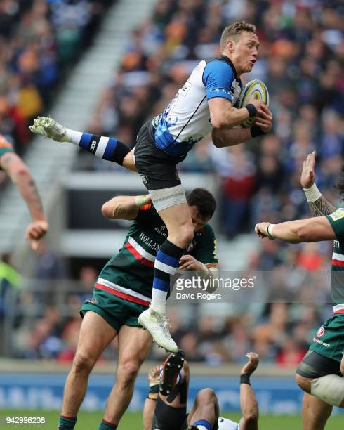 James Wilson of Bath is upended by Adam Thompstone during the Aviva Premiership match between Bath Rugby and Leicester Tigers at Twickenham Stadium...