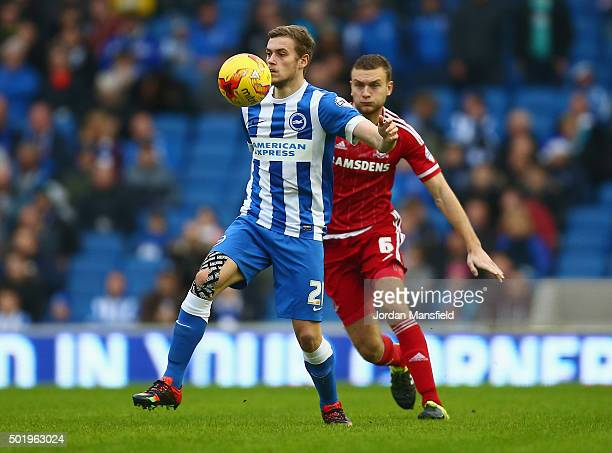 James Wilson of Brighton and Hove Albion shields the ball from Ben Gibson of Middlesbrough during the Sky Bet Championship match between Brighton and...