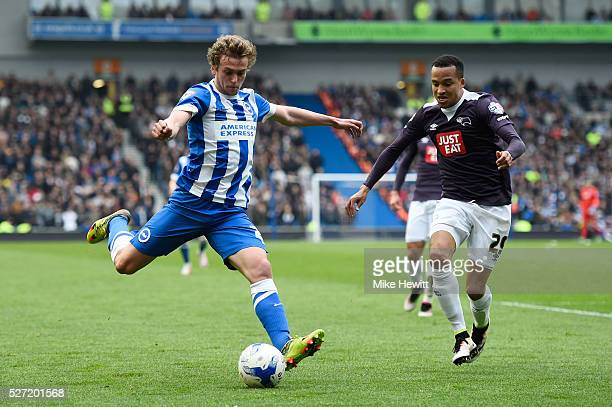 James Wilson of Brighton and Hove Albion takes a shot on goal under pressure from Marcus Olsson of Derby County during the Sky Bet Championship match...