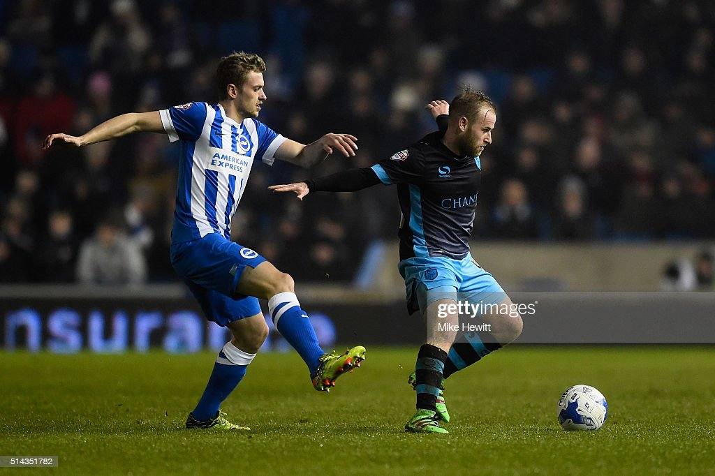 James Wilson of Brighton & Hove Albion challenges Barry Bannan of Sheffield Wednesday during the Sky Bet Championship match between Brighton and Hove Albion and Sheffield Wednesday at the Amex Stadium on March 8, 2016 in Brighton, United Kingdom.
