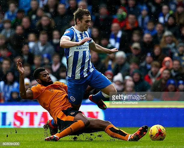 James Wilson of Brighton is tackled by Wolves Ethan EbanksLandell during the Sky Bet Championship match between Brighton and Hove Albion and...