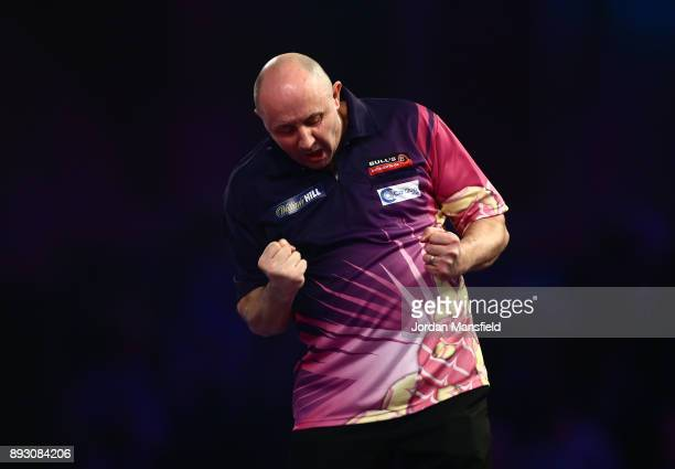 James Wilson of England celebrates victory in his first round match against Krzysztof Ratajski of Poland during day one of the 2018 William Hill PDC...
