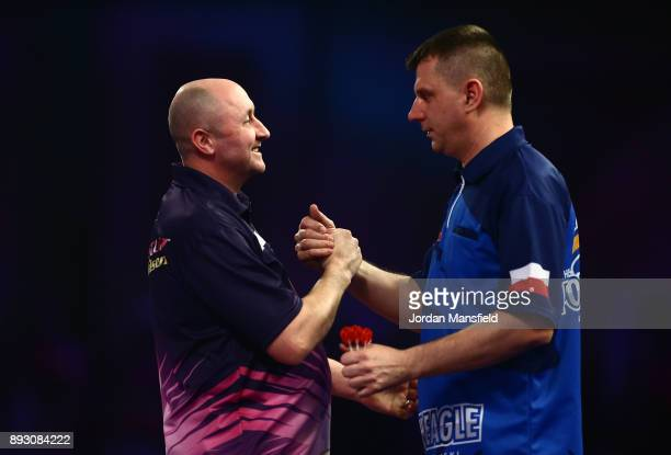 James Wilson of England shakes hands with Krzysztof Ratajski of Poland after victory in their first round match during day one of the 2018 William...