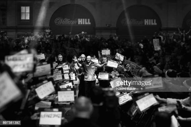 James Wilson of England walks onto the stage prior to the second round match against Michael van Gerwen of the Netherlands on day nine of the 2018...