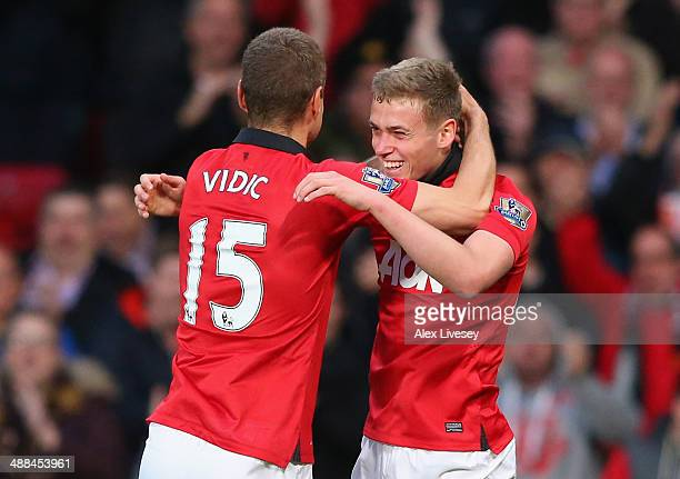 James Wilson of Manchester United celebrates scoring the first goal with teammate Nemanja Vidic during the Barclays Premier League match between...