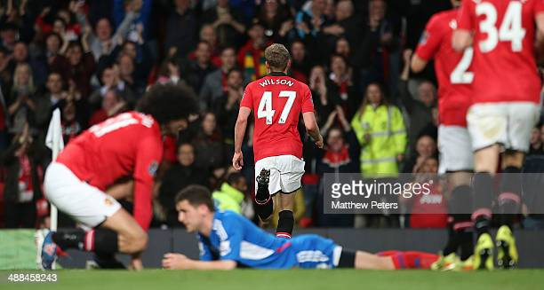 James Wilson of Manchester United celebrates scoring their second goal during the Barclays Premier League match between Manchester United and Hull...