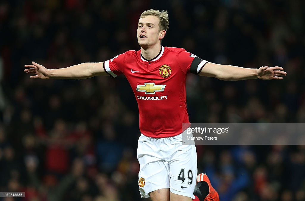 James Wilson of Manchester United celebrates scoring their third goal during the FA Cup Fourth Round replay match between Manchester United and Cambridge United at Old Trafford on February 3, 2015 in Manchester, England.