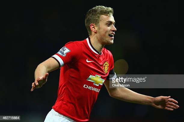 James Wilson of Manchester United celebrates scoring their third goal during the FA Cup Fourth round replay match between Manchester United and...