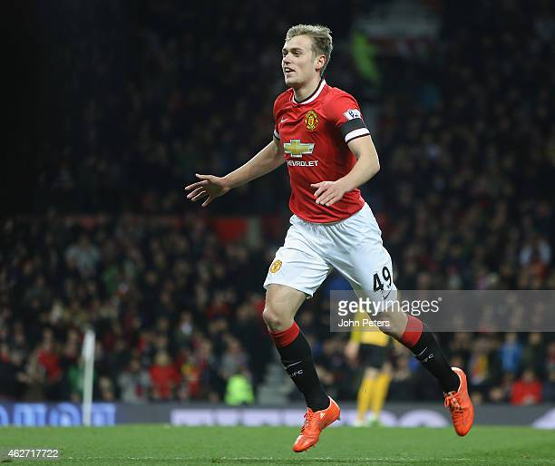 James Wilson of Manchester United celebrates scoring their third goal during the FA Cup Fourth Round replay between Manchester United and Cambridge...