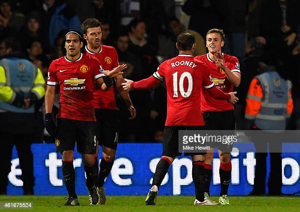 James Wilson of Manchester United celebrates with teammates after scoring his team's second goal past Robert Green of QPR during the Barclays Premier...