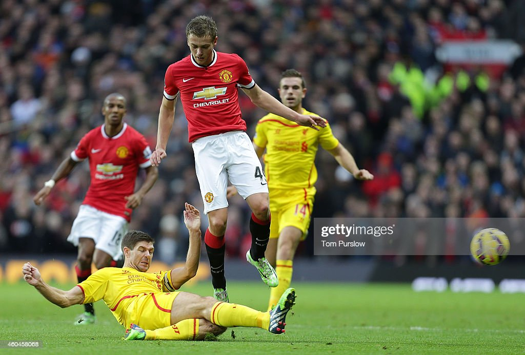 James Wilson of Manchester United in action with Steven Gerrard of Liverpool during the Barclays Premier League match between Manchester United and Liverpool at Old Trafford on December 14, 2014 in Manchester, England.