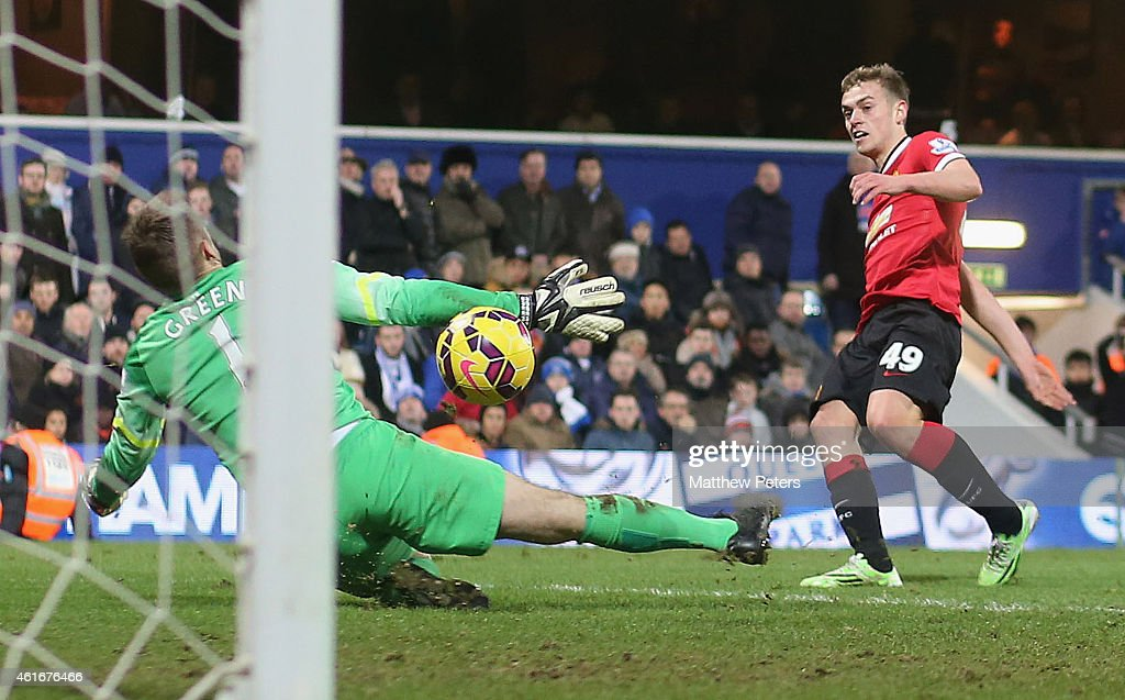 James Wilson of Manchester United scores their second goal during the Barclays Premier League match between Queens Park Rangers and Manchester United at Loftus Road on January 17, 2015 in London, England.