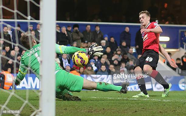 James Wilson of Manchester United scores their second goal during the Barclays Premier League match between Queens Park Rangers and Manchester United...