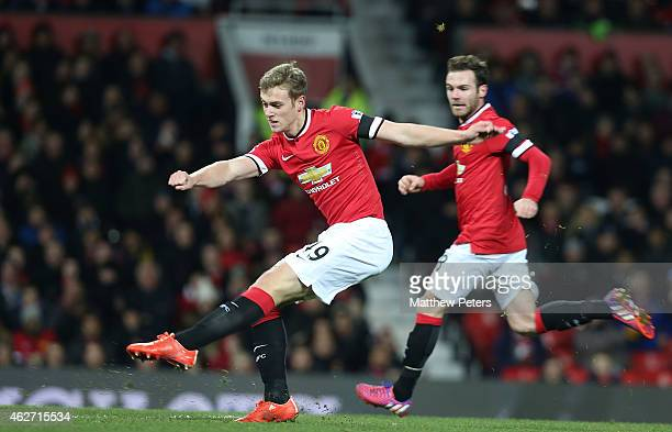 James Wilson of Manchester United scores their third goal during the FA Cup Fourth Round replay match between Manchester United and Cambridge United...