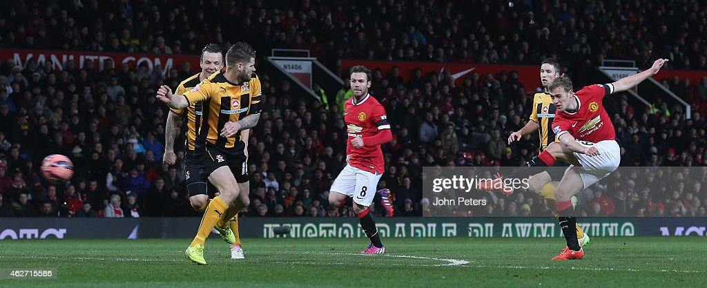 James Wilson of Manchester United scores their third goal during the FA Cup Fourth Round replay between Manchester United and Cambridge United at Old Trafford on February 3, 2015 in Manchester, England.