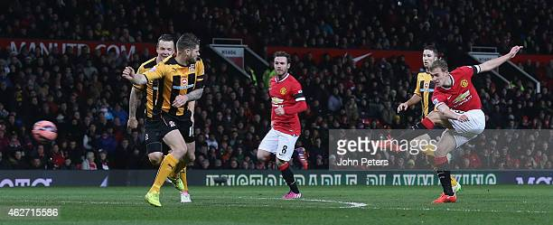 James Wilson of Manchester United scores their third goal during the FA Cup Fourth Round replay between Manchester United and Cambridge United at Old...