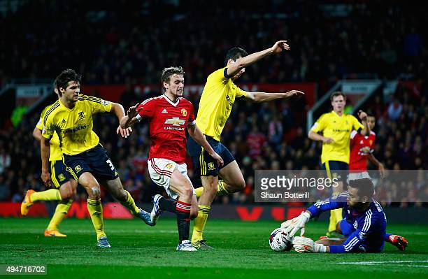 James Wilson of Manchester United sees goalkeeper Tomas Mejias of Middlesbrough gather the ball after an attack during the Capital One Cup Fourth...