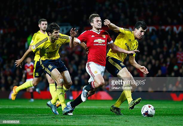 James Wilson of Manchester United takes on George Friend and Daniel Ayala of Middlesbrough during the Capital One Cup Fourth Round match between...