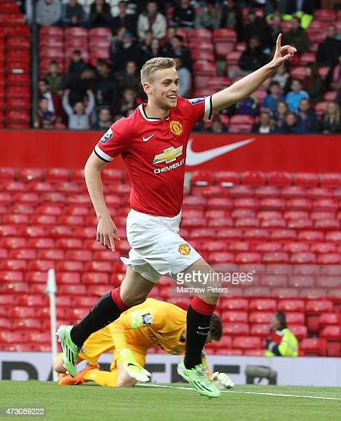 James Wilson of Manchester United U21s celebrates scoring their first goal during the Barclays U21 Premier League match between Manchester United and...