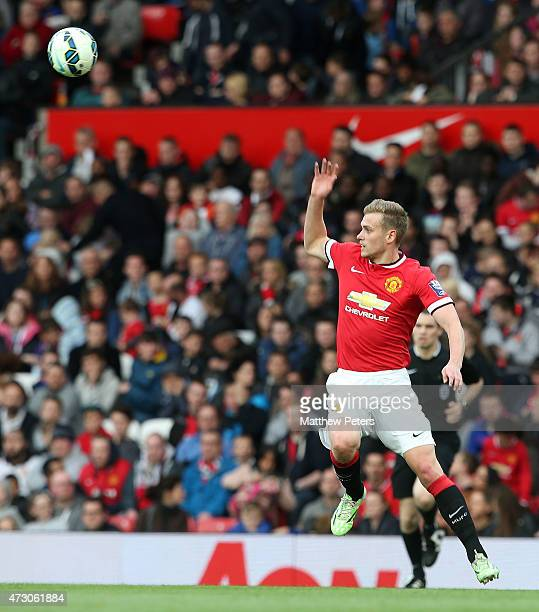 James Wilson of Manchester United U21s in action during the Barclays U21 Premier League match between Manchester United and Manchester City at Old...