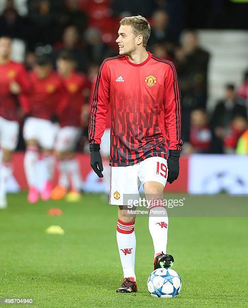 James Wilson of Manchester United warms up ahead of the UEFA Champions League match between Manchester United and PSV Eindhoven at Old Trafford on...