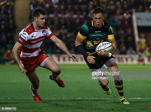 James Wilson of Northampton breaks with the ball during the Aviva Premiership match between Northampton Saints and Gloucester Rugby at Franklin's...