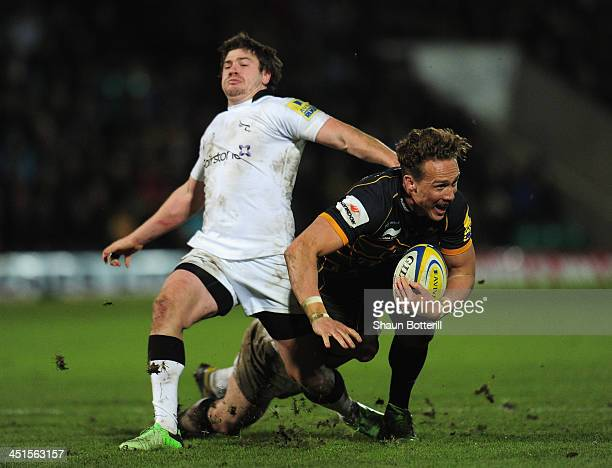 James Wilson of Northampton Saints tries take break through the Newcastle Falcons' defence during the Aviva Premiership match between Northampton...
