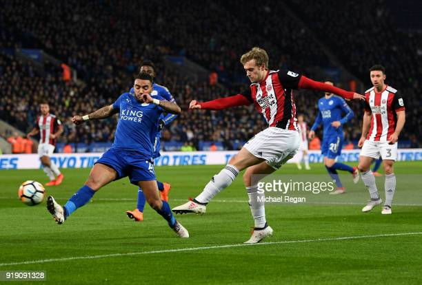 James Wilson of Sheffield United shoots past Danny Simpson of Leicester during The Emirates FA Cup Fifth Round match between Leicester City and...