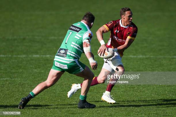James Wilson of Southland attempts to evade Fraser Armstrong of Manawatu during the round nine Mitre 10 Cup match between Manawatu and Southland at...