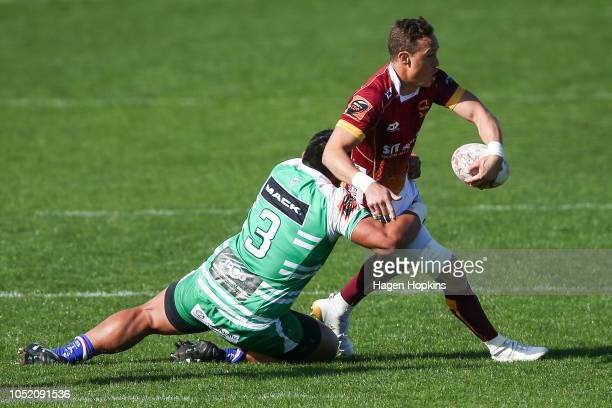 James Wilson of Southland is tackled by Michael Alaalatoa of Manawatu during the round nine Mitre 10 Cup match between Manawatu and Southland at...