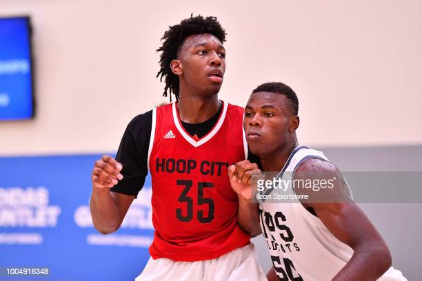 James Wiseman from East Memphis High School and Oscar Tshiebwe from Kennedy Catholic High School look on during the adidas Summer Championships on...