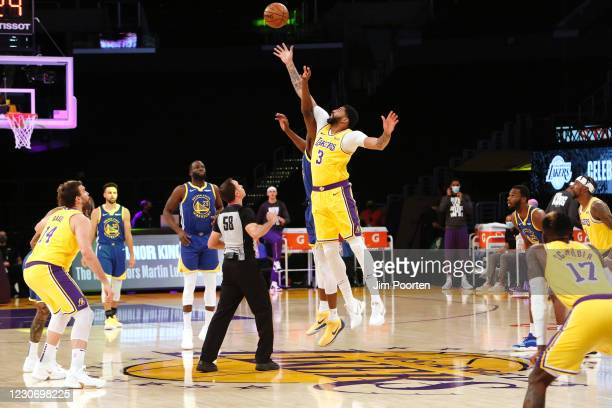 James Wiseman of the Golden State Warriors jumps the opening tip against Anthony Davis of the Los Angeles Lakers on January 18, 2021 at STAPLES...