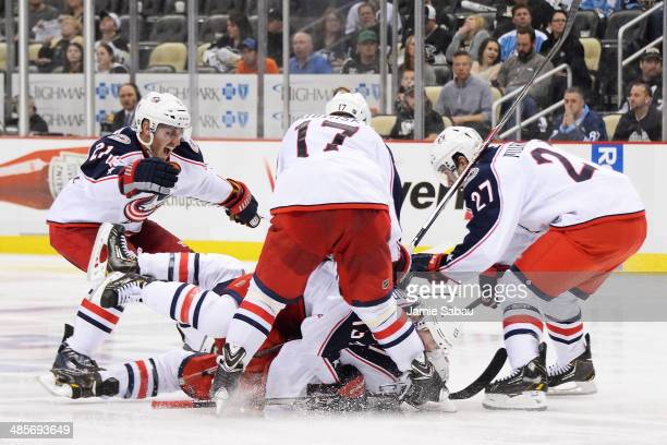 James Wisniewski, Brandon Dubinsky, Ryan Murray and Cam Atkinson, all of the Columbus Blue Jackets, celebrate with Matt Calvert who scored the...