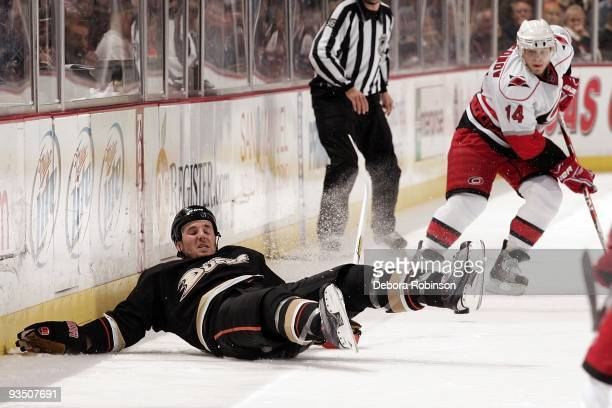 James Wisniewski of the Anaheim Ducks falls to the ice during the game against the Carolina Hurricanes on November 25 2009 at Honda Center in Anaheim...