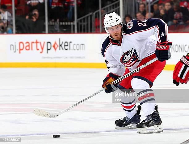 James Wisniewski of the Columbus Blue Jackets looks for a shot in the third period against the New Jersey Devils at Prudential Center on February 27...