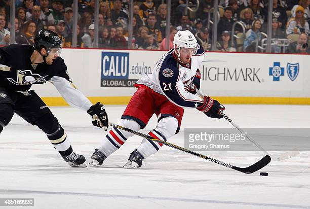 James Wisniewski of the Columbus Blue Jackets moves the puck in front of Brandon Sutter of the Pittsburgh Penguins at Consol Energy Center on March 1...