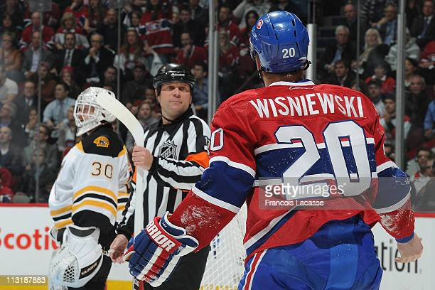 James Wisniewski of the Montreal Canadiens talks to referee Dan O'Halloran in Game Three of the Eastern Conference Quarterfinals against the Boston...