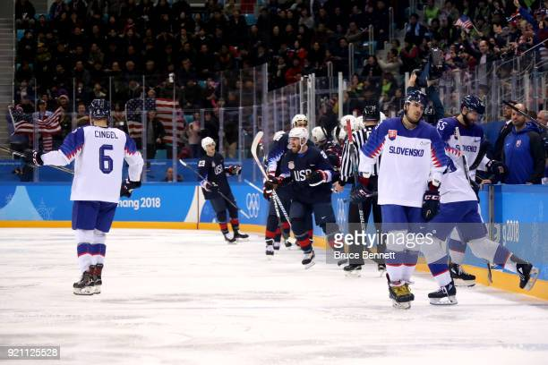 James Wisniewski of the United States celebrates after with his teammates after scoring a goal against Jan Laco of Slovakia in the second period...