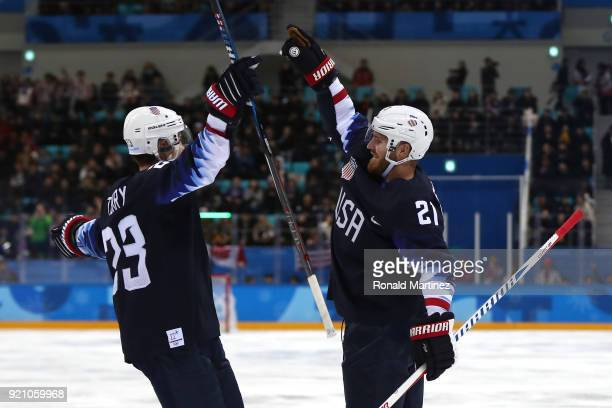 James Wisniewski of the United States celebrates after with his teammate Troy Terry after scoring a goal against Jan Laco of Slovakia in the second...