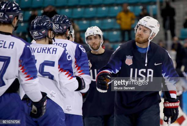 James Wisniewski of the United States shakes hands with Marek Hovorka of Slovakia after their Men's Playoffs Qualifications game on day eleven of the...