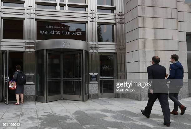 James Wolfe former director of security for the Senate Intelligence Committee walks in to the Washington FBI Field Office to be processed on June 11...